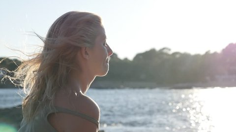 Daydreaming of blond female close-up 4K 2160p 30fps UltraHD footage - Caucasian woman enjoying nice weather before sunset 3840X2160 UHD video