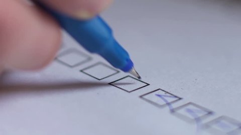 Cropped of businessman writing on checklist