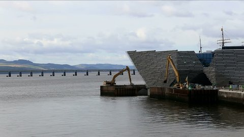 Dundee, Scotland September 12: Virgin East Coast train on Tay Rail Bridge and longreach excavators removing cofferdam at V&A Design Museum Dundee Scotland 12th September 2017