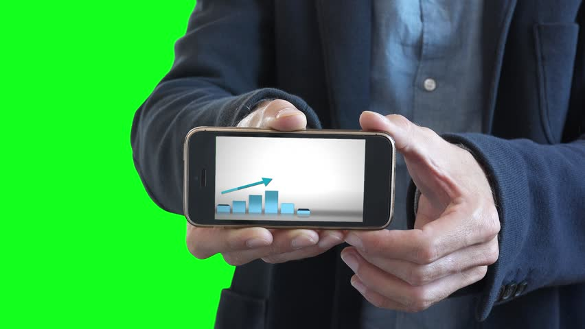 Businessman With Positive Chart In Smartphone On Green Screen. Man holding a smartphone with a positive chart in a business presentation | Shutterstock HD Video #30801253