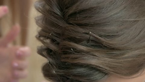 Female hairdo close up. Hair with bobby pins.