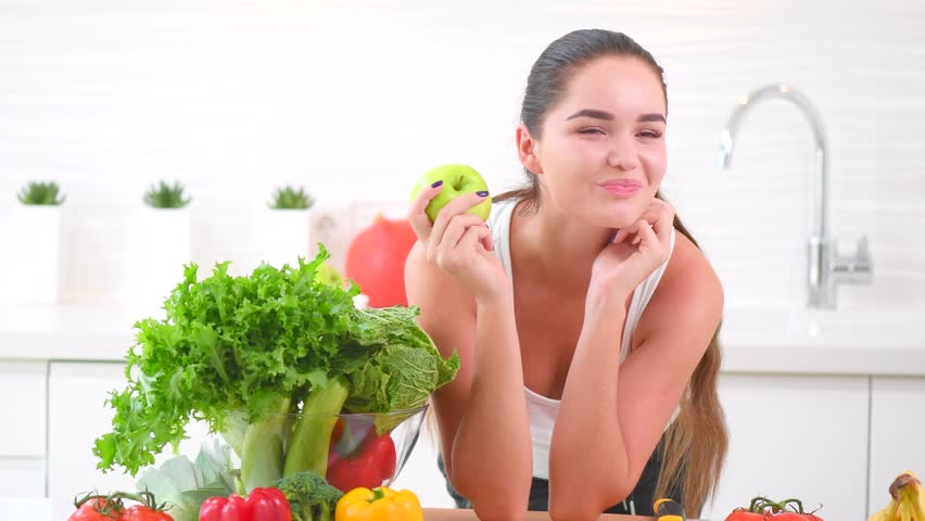 Beauty Young Woman Eating Organic Apple Fresh Vegetables And Fruits Smiling In Her Kitchen