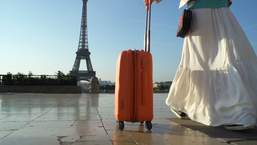 Young Woman with the Orange Suitcase Traveling to Paris. Eiffel Tower Background. | Shutterstock HD Video #30867814