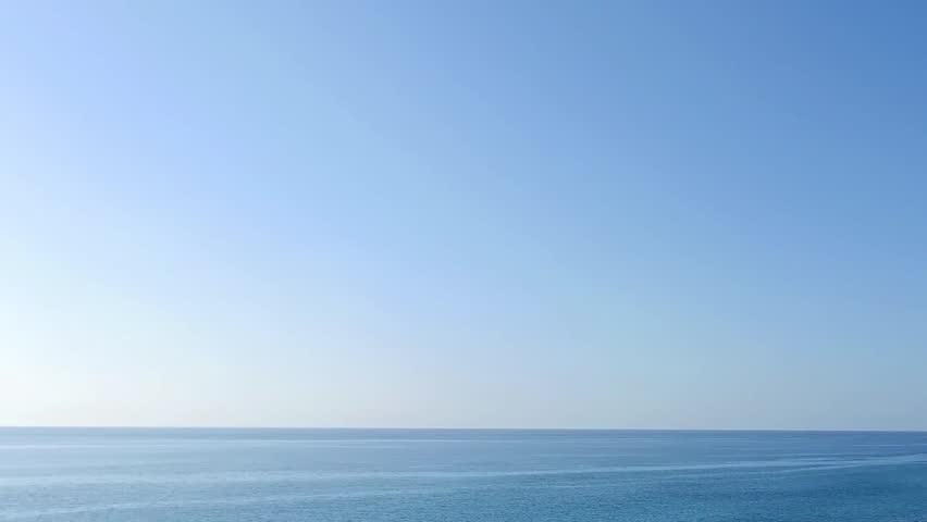 Clear blue ocean & sky horizon, panorama blue skies, sunset with blue sexy sea, Sea, seascape, ocean, nature background. Idyllic seascape: clean water, waves, blue sky, horizon. Sea water surface.
