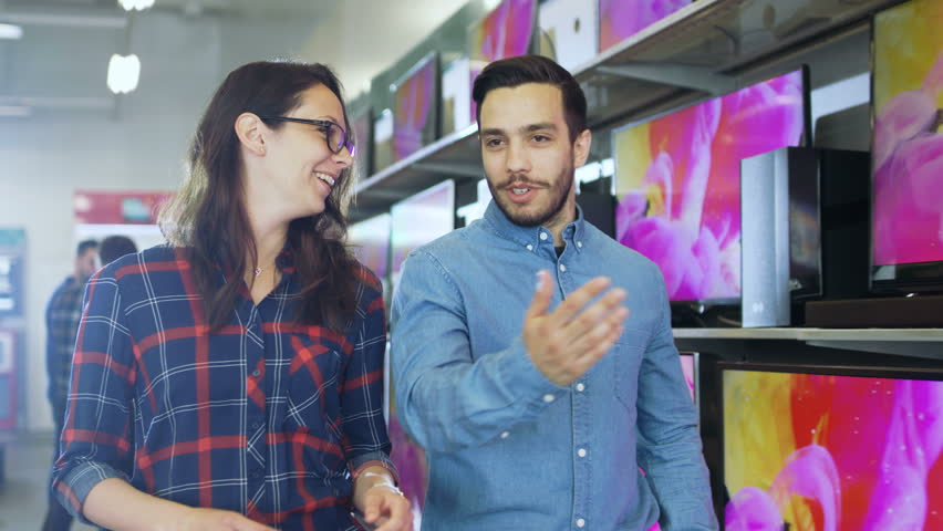 Young Couple Walking and Talking in the Electronics Store, Choosing and Deciding on a New TV set. Shot on RED EPIC-W 8K Helium Cinema Camera. | Shutterstock HD Video #30883951