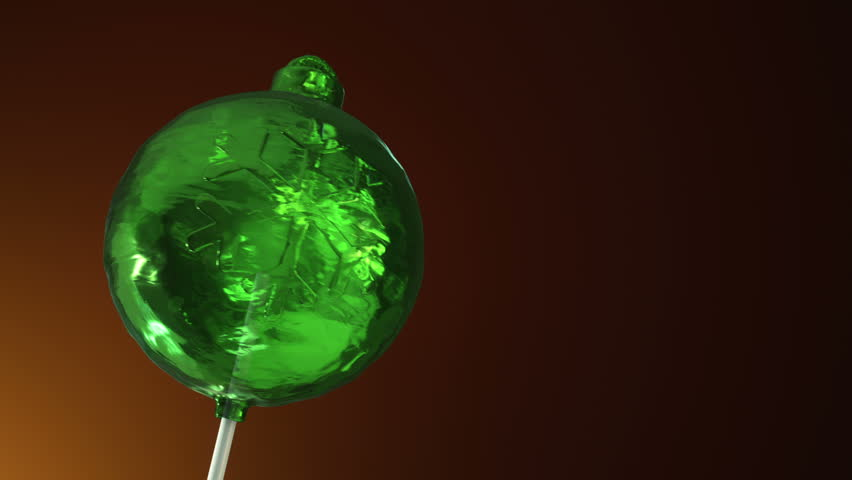 Animation of rotation lollipop candy on plastic stick as form of christmas ball for christmas tree on colorful background. Animation of seamless loop. | Shutterstock HD Video #30894229