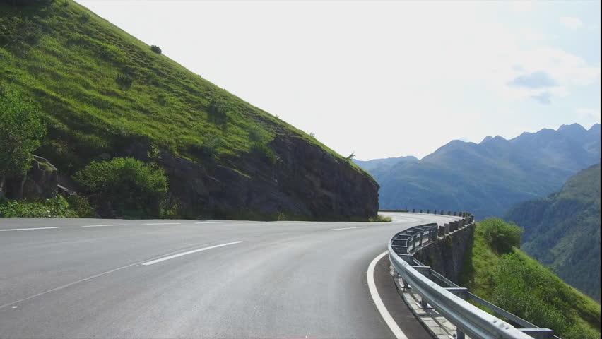 Driving on rural road to Grossglockner at the alps in Austria