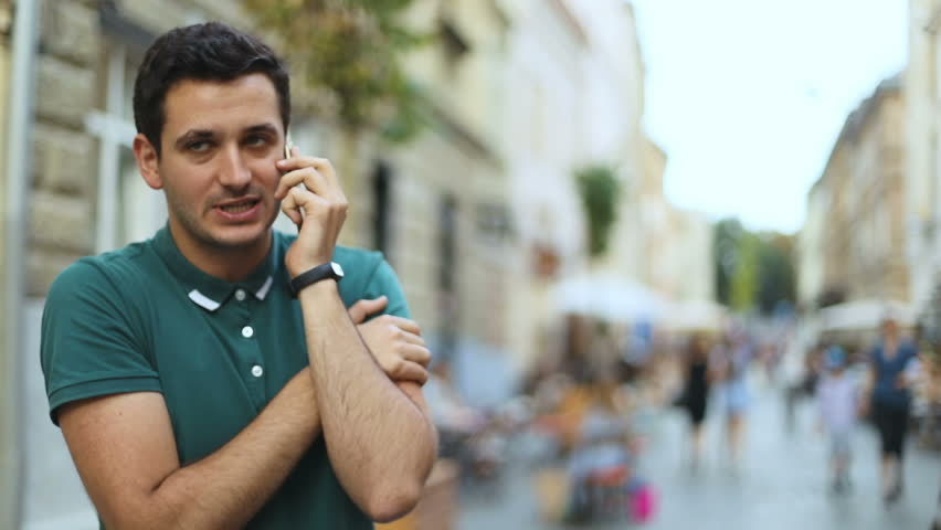 Closeup portrait worried nervously depressed italian young man employee worker talking phone blurred street background human face expression emotion feeling emotional disappointed stress conflict | Shutterstock HD Video #30929719