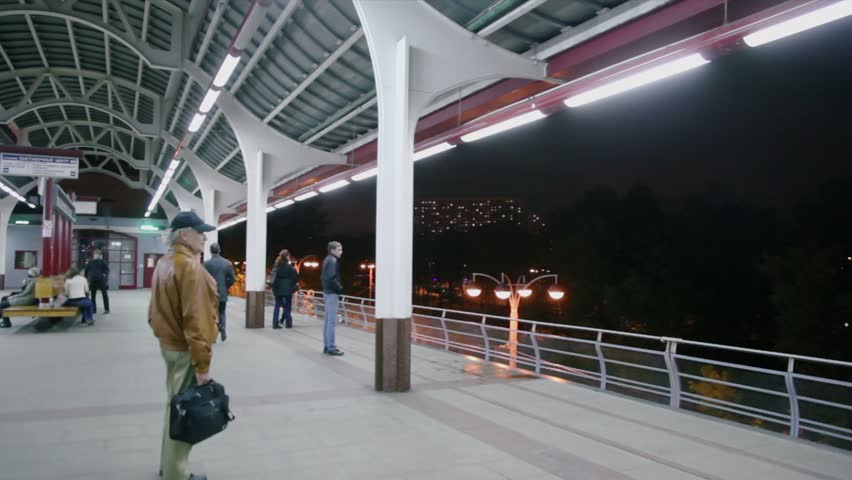 MOSCOW - OCTOBER 2: Several people wait for train on monorail station at night on October 2, 2011 in Moscow, Russia. | Shutterstock HD Video #3095719