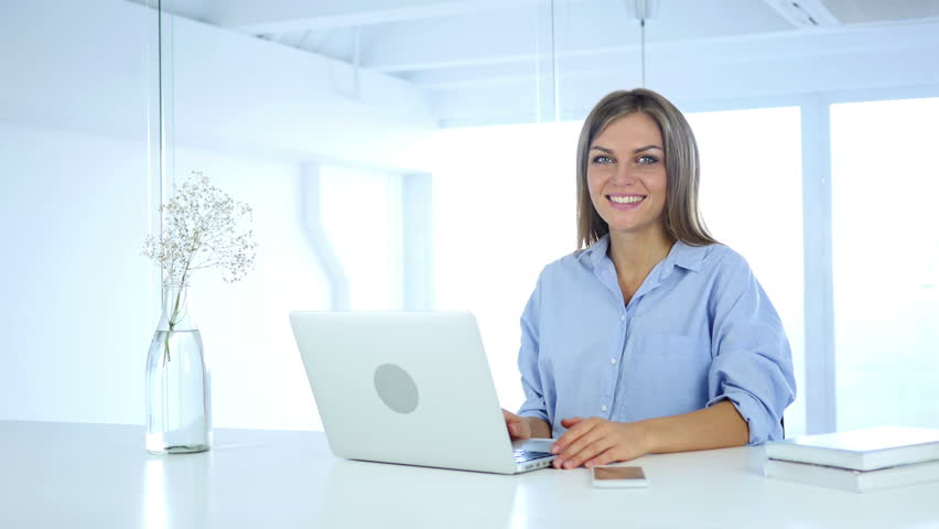 Smiling Young Woman at Work looking Toward Camera | Shutterstock HD Video #30969355