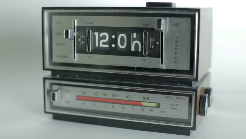Stop motion of an old style flip clock passing through 12 hours | Shutterstock HD Video #3097489