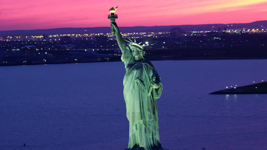 Aerial view of the Statue of Liberty at dusk. Manhattan, New York City. United States. Shot from a helicopter.   | Shutterstock HD Video #30979849