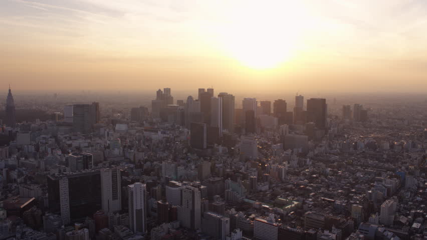Japan Tokyo Aerial v152 Flying over Shinjuku area towards downtown cityscape views sunset