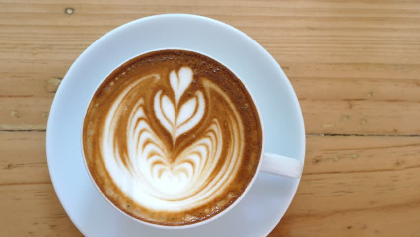 Closeup Of Cappuccino Or Latte Coffee With Heart Shape Art. 4K.  | Shutterstock HD Video #30986185