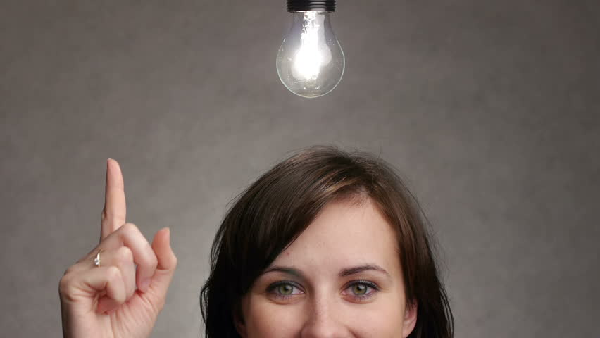 bulb lights up over a woman head when she gets an idea