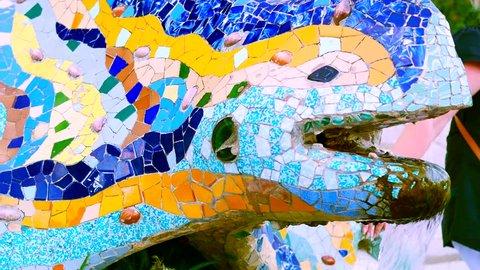 Colorful mosaics, on a salamander shaped fountain, close up