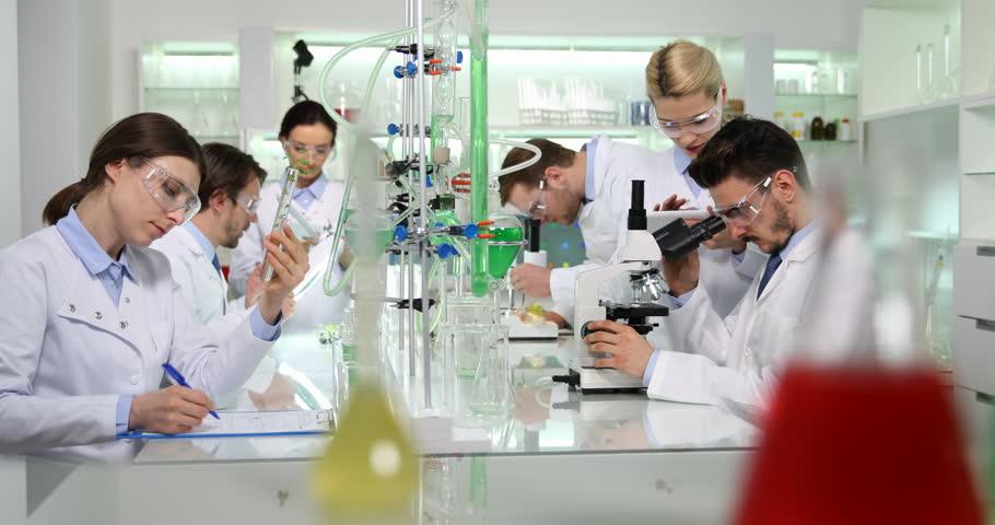 Scientific Researchers Talking Communication Microscope Stock ...