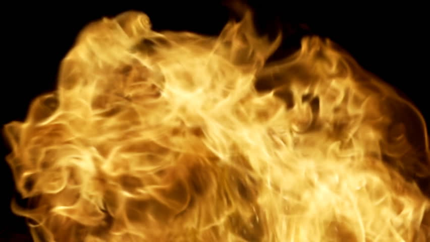 Huge, frame-filling slow motion flames and sparks, roiling and twisting.