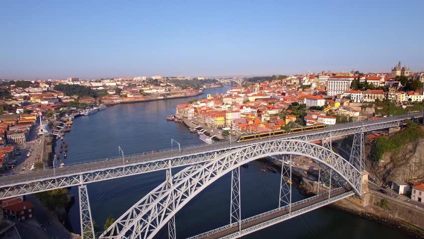 Porto Old Town and Dom Luis Bridge over the Douro river in Porto, Portugal, aerial view.