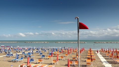 bathhouse with waving   red flag in Italy