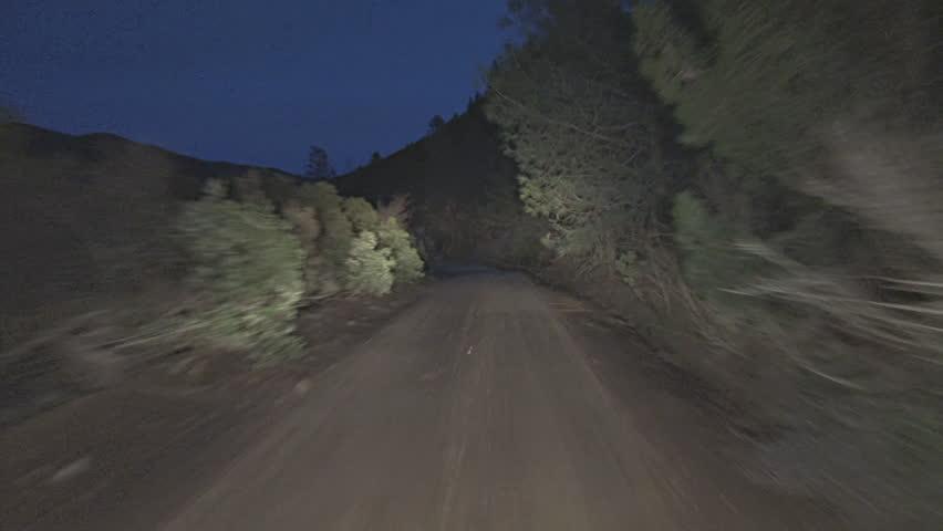 Driving POV shot, Mendocino National Forest, Bartlett Springs Road, dirt, at