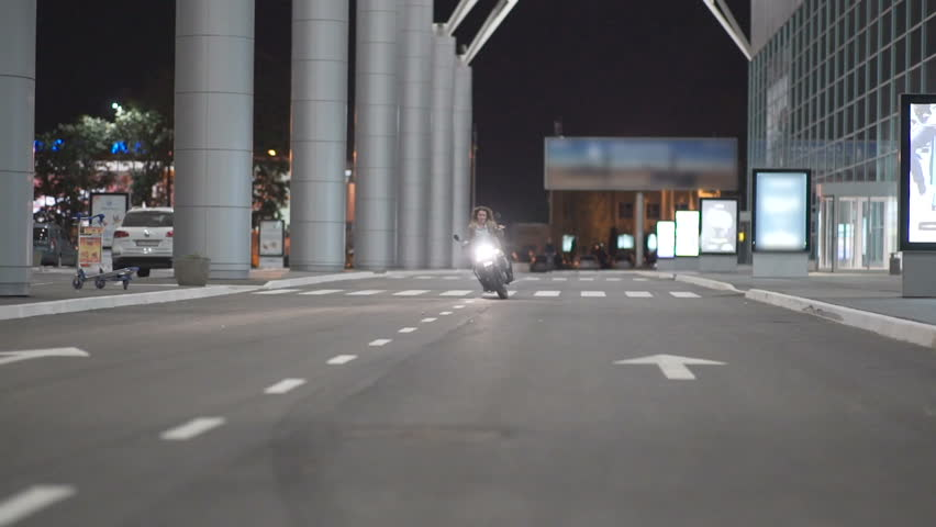 Two beautiful young women riding a motorcycle at night on city street and talking to each other. Female biker with his girlfriend | Shutterstock HD Video #31014949