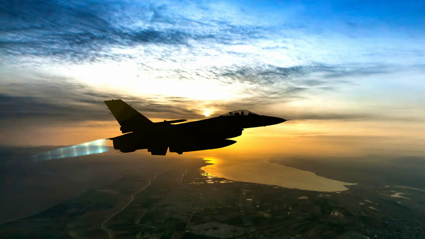 Fighter F-16 with afterburner fly at sunrise