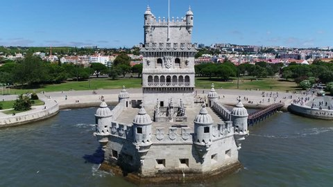 Aerial bird view flying over Belem Tower Torre de Belem or Tower of St Vincent is fortified tower located in civil parish of Santa Maria de Belem in Lisbon Portugal is UNESCO World Heritage Site 4k