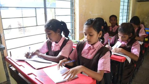 AMRAVATI, MAHARASHTRA, INDIA 22 SEPTEMBER 2017 :  unidentified rural school student learning from books in the classroom of their school, scene in a rural or small village school in India