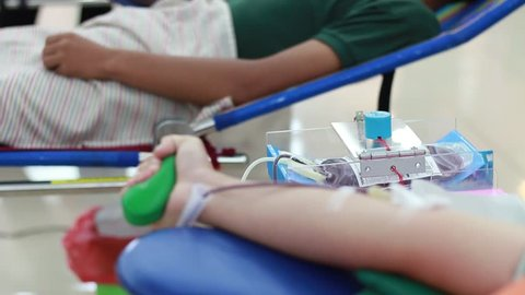 Blurred of for Blood donation or transfusion with a bouncy ball holding in hand, Concept of World health care. Bloods donation occurs when a person voluntarily has blood drawn, used for transfusions.
