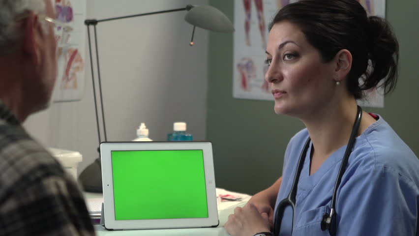 Doctor discussing results with patient on tablet, green screen