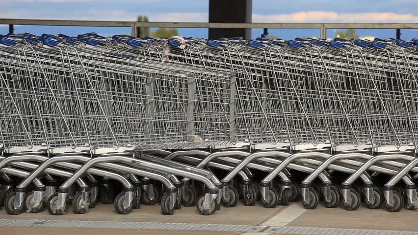 Line of many shopping baskets | Shutterstock HD Video #3111646