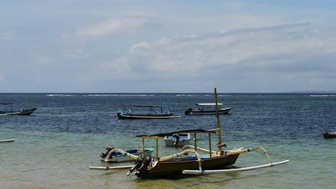 "Traditional balinese ""dragonfly"" boat on the beach. Jukung fishing boats on Sanur beach, Bali, Indonesia, Asia"