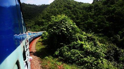 Tracking shot of a train moving in the Araku Valley, Visakhapatnam, Andhra Pradesh, India