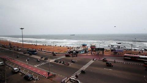 Pan shot of traffic moving on the Beach Road at Ramakrishna Beach, Visakhapatnam, Andhra Pradesh, India