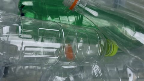 Plastic bottles, recyclable. Tracking shot above many recyclables bottles. Recycling concept. 2 out of 3