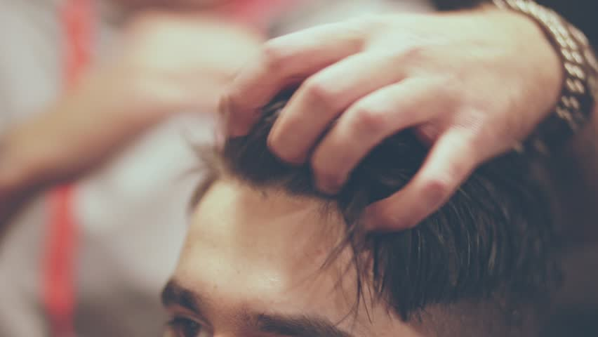 Wet hairstyling man. Close up of barber hairdressing male head. Barber haircut doing male hair style