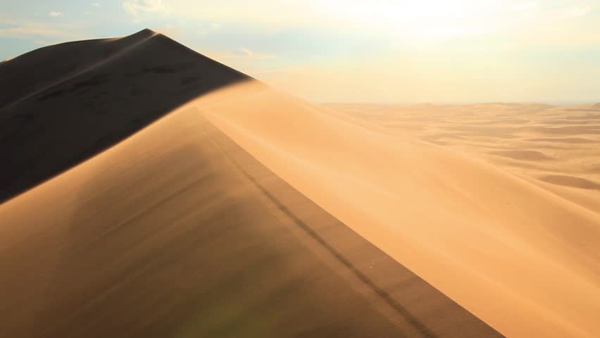 Beautiful sunset in the desert. Sandstorm on the dune