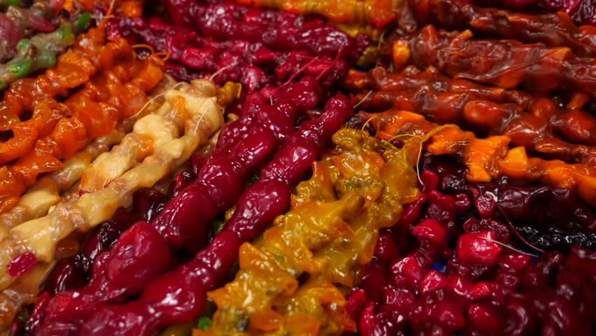 Spices, nuts, dried fruits on display at market on the counter, 4k, slow-motion