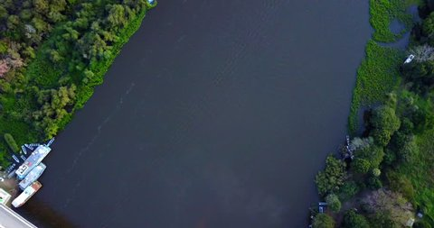 Aerial image of bridge over the river. Houses on the bank. Forest in the Pantanal Biome. Top view. Mato Grosso do Sul state, Central-Western - Brazil.