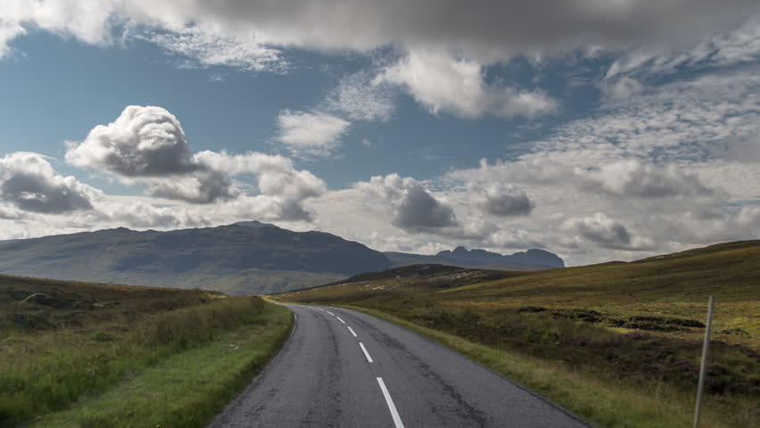 POV shot from a camera attached to the front of a vehicle driving through beautiful empty roads in the scottish highlands | Shutterstock HD Video #31257439