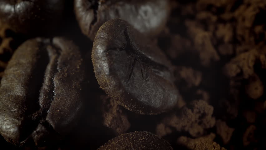 Coffee beans in extreme close up background stock footage. Coffee beans in macro close up with Coffee granules background. | Shutterstock HD Video #31262509