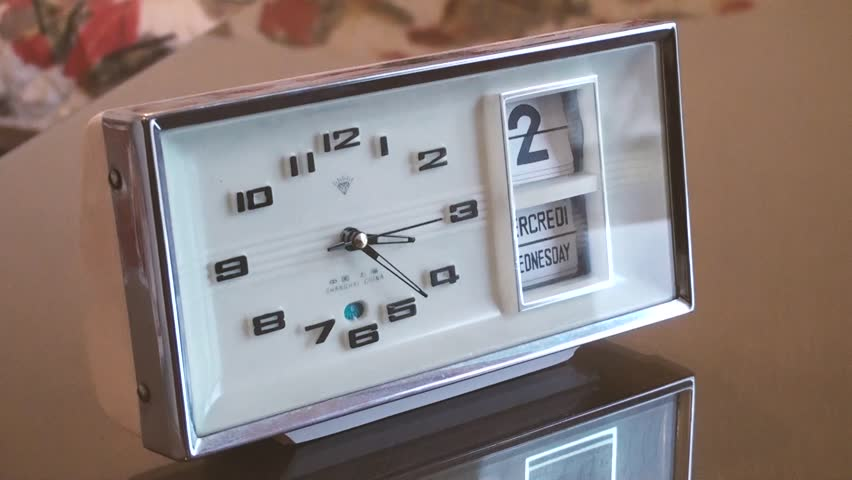 White metal analog clock with date and weeks. | Shutterstock HD Video #31287673