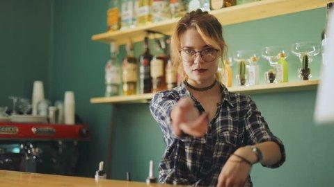 Happy bartender barmaid waitress barkeeper having fun enjoying dancing break working day young caucasian woman girl looking camera stylish female person social lifestyle bar cafe drink cheerful