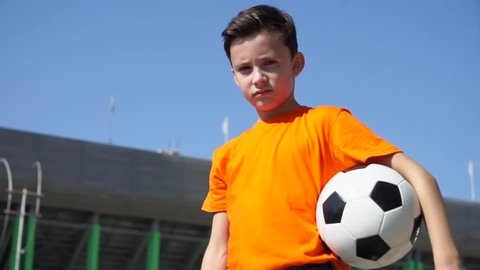 The Young Football Player Seriously Looks At You