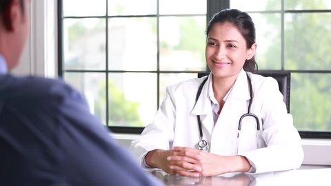 Closeup portrait, patient talking good news conversation about improved health to healthcare professional, isolated indoors office window background
