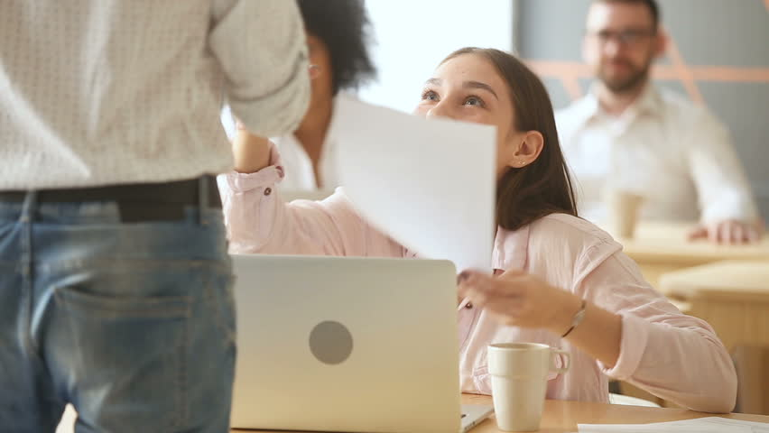 Young excited woman gets paper with good news from executive, boss handshaking promoting appreciating manager while colleagues applaud, congratulates happy girl with achievement, employee recognition | Shutterstock HD Video #31351939