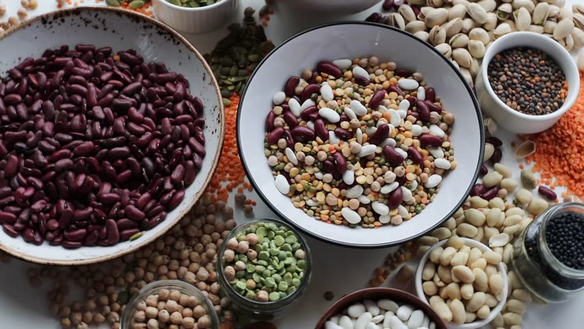Various dry legumes on a wooden background. Top view