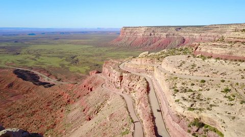 CIRCA 2010s - Moki Dugway, New Mexico - Cars travel on the dangerous mountain road of Moki Dugway, New Mexico, desert Southwest.