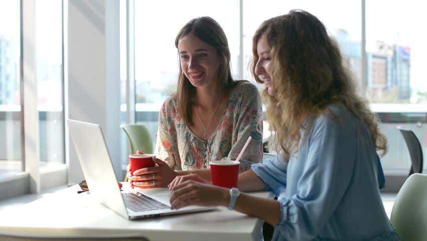 Girls Using laptop computer in coffee shop   Shutterstock HD Video #31368424
